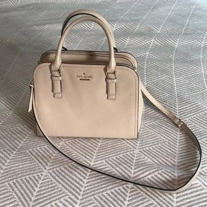 Kate Spade cream purse with gold details